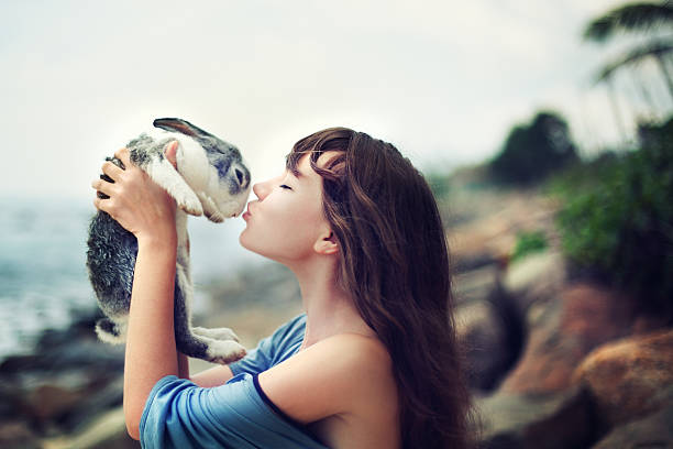 Young woman with rabbit stock photo