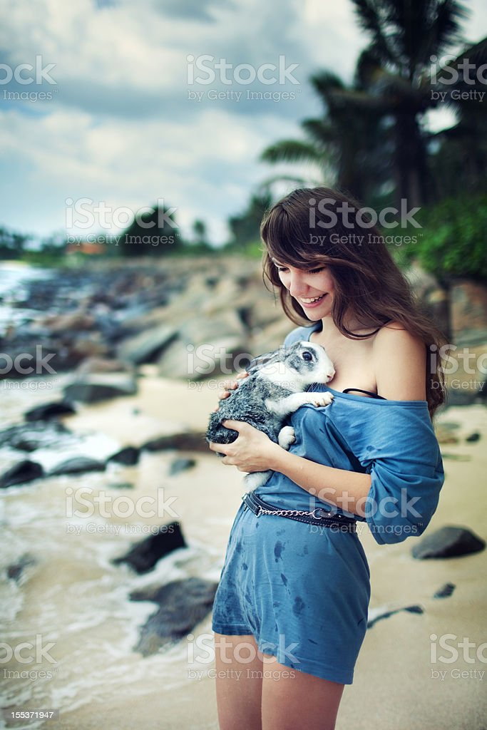 Young woman with rabbit royalty-free stock photo