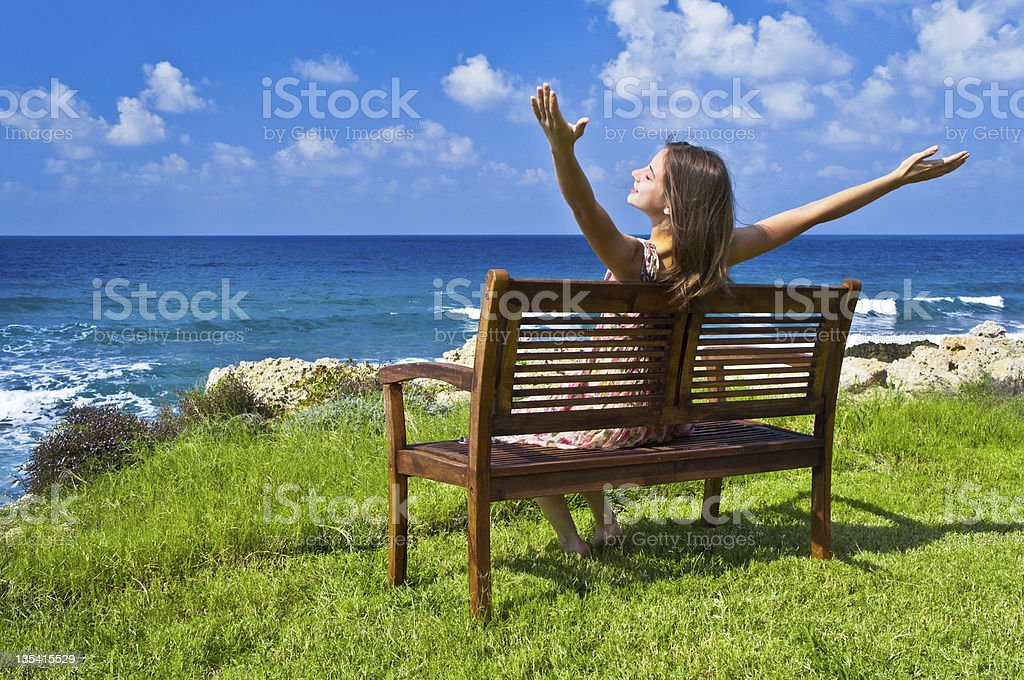Young woman with raised hands stock photo