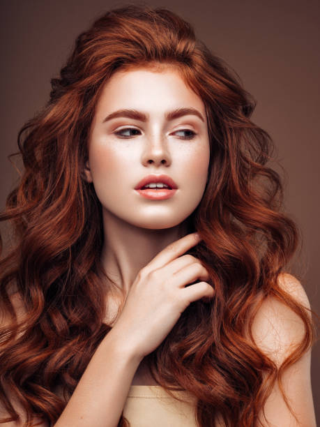 Young woman with red hair Young woman with red hair redhead stock pictures, royalty-free photos & images