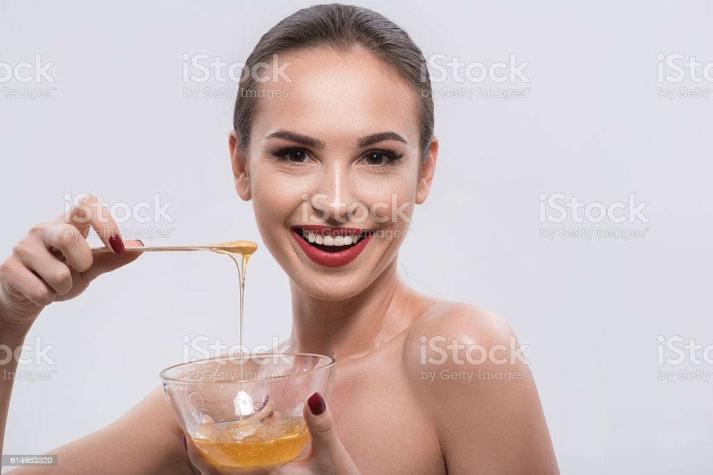 Young woman with red lips and nails in studio stock photo