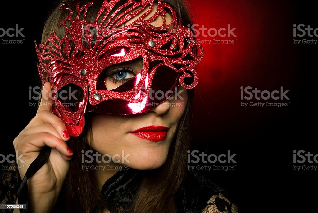 Young woman with red mask and lipstick stock photo