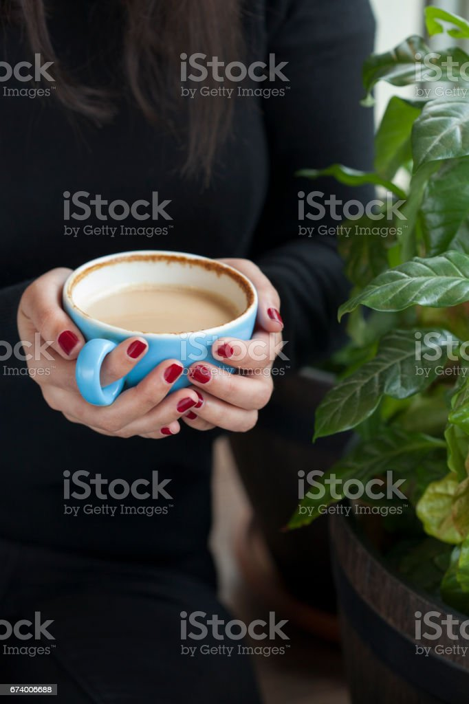 Young Woman with Red Nails Holding a Coffee royalty-free stock photo