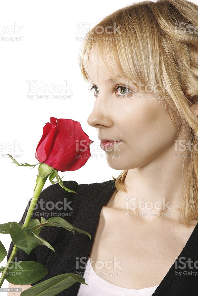 Young woman with red rose sideview royalty-free stock photo