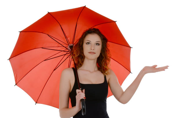 Young woman with red umbrella checking if it's raining – zdjęcie