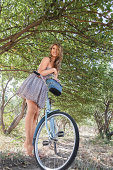 istock Young woman with retro bicycle in a park 179002715