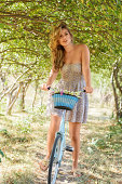 istock Young woman with retro bicycle in a park 179022591