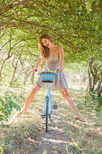 istock Young woman with retro bicycle in a park 179034533