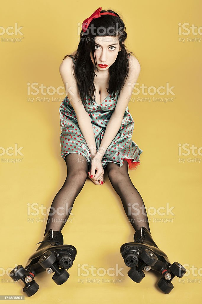 Young woman with roller skates stock photo