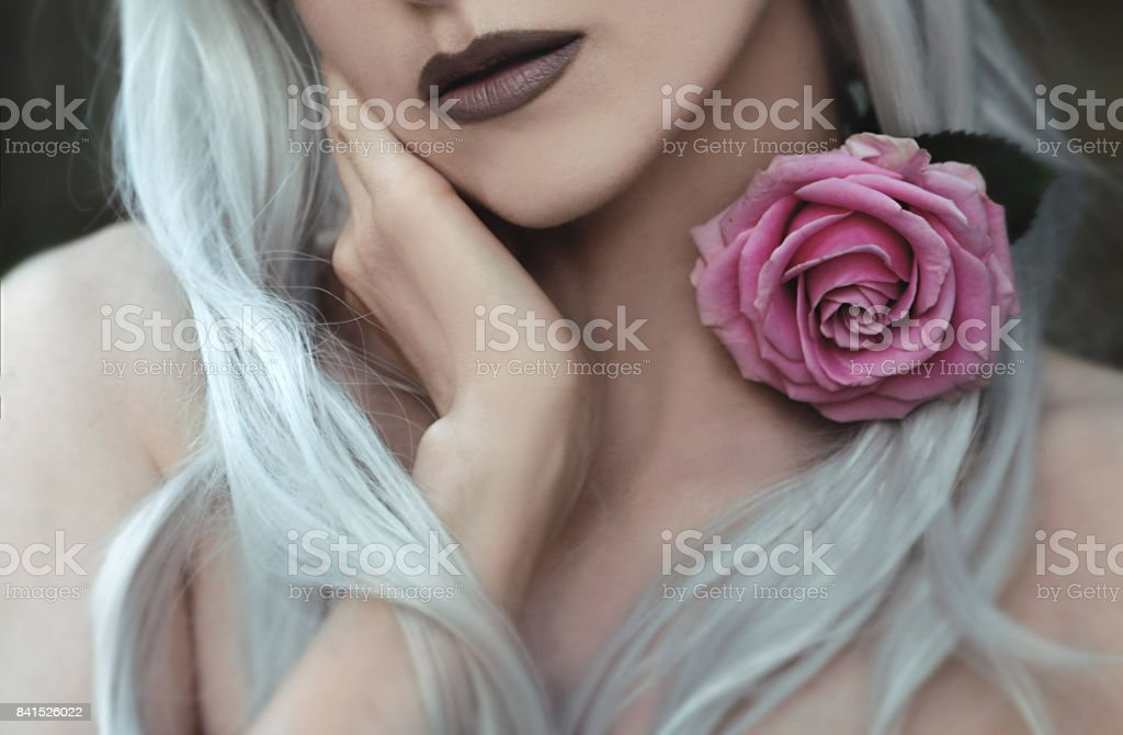 Young woman with rose flower stock photo