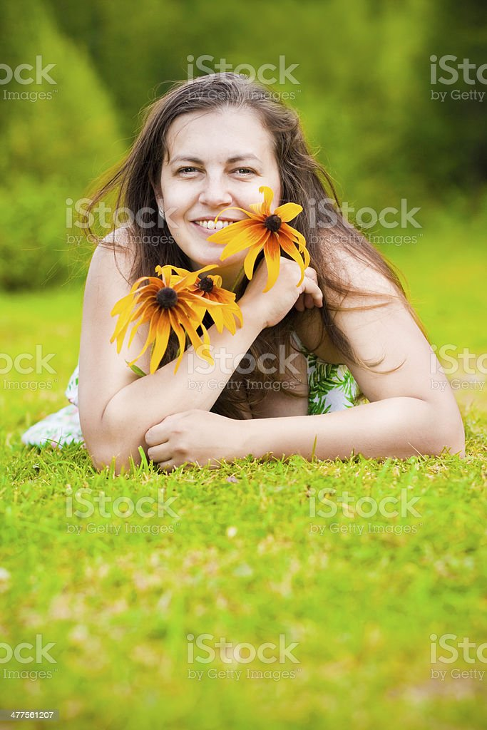 Young woman with rudbeckia royalty-free stock photo