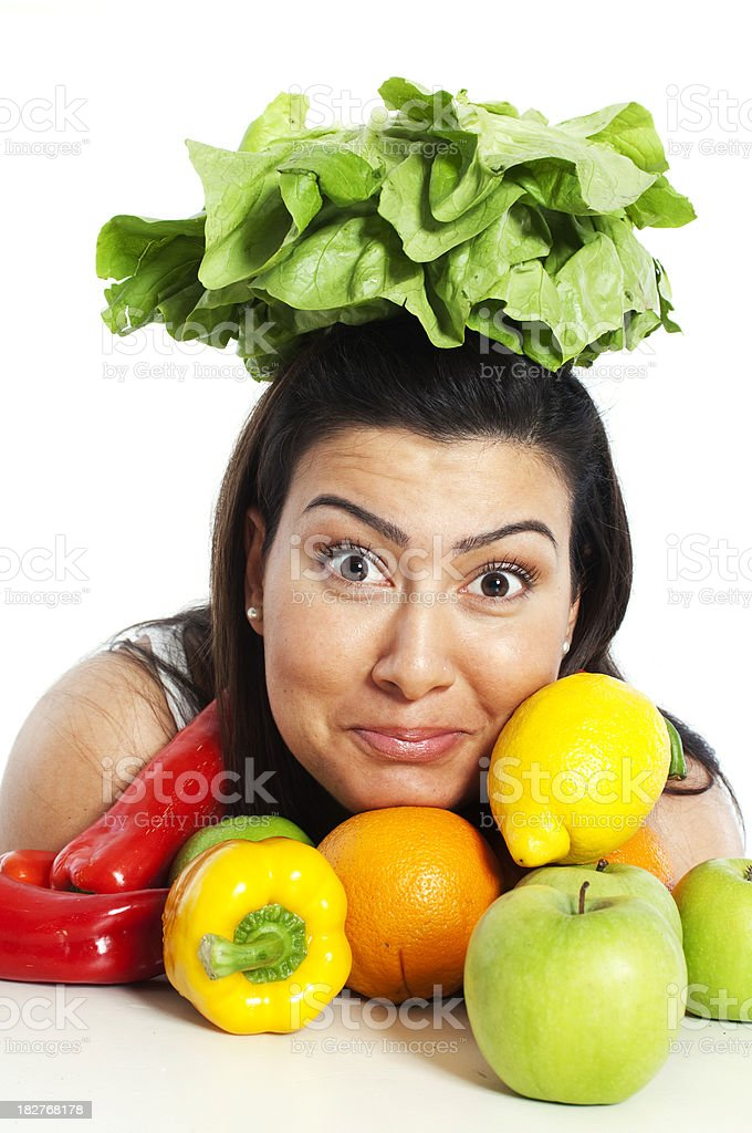 Young woman with salad on her head royalty-free stock photo