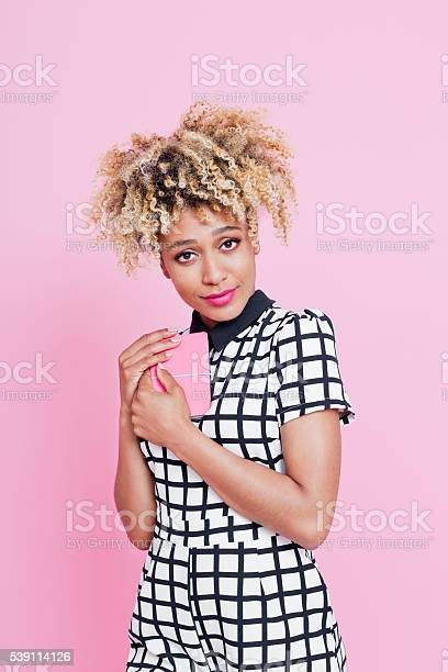 Young Woman With Secret Notebook Stock Photo - Download Image Now