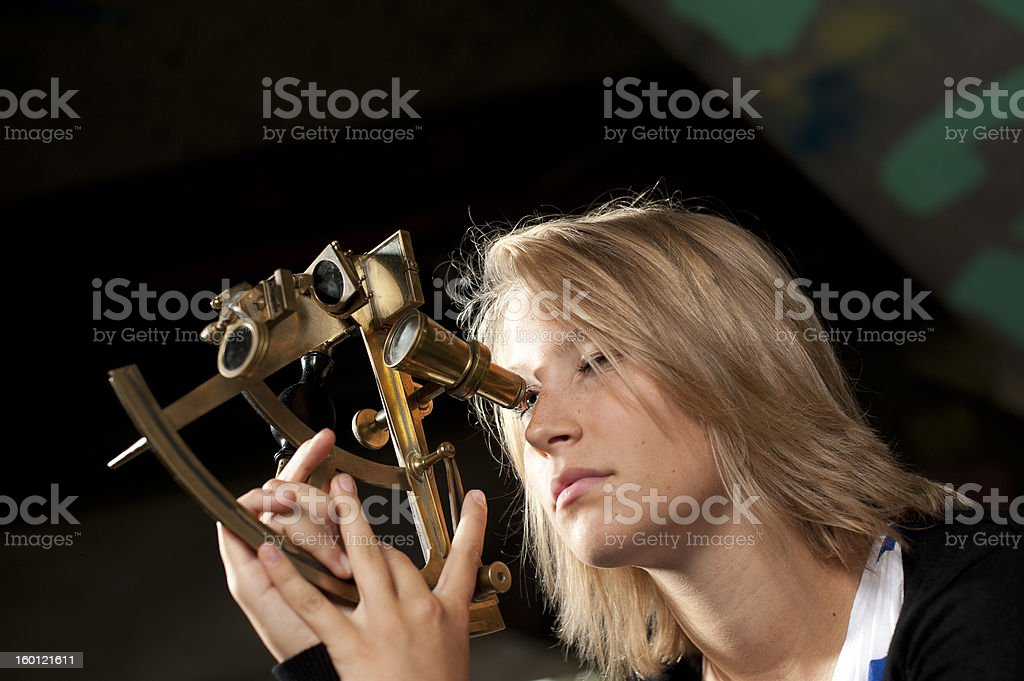 Young woman with sextant stock photo