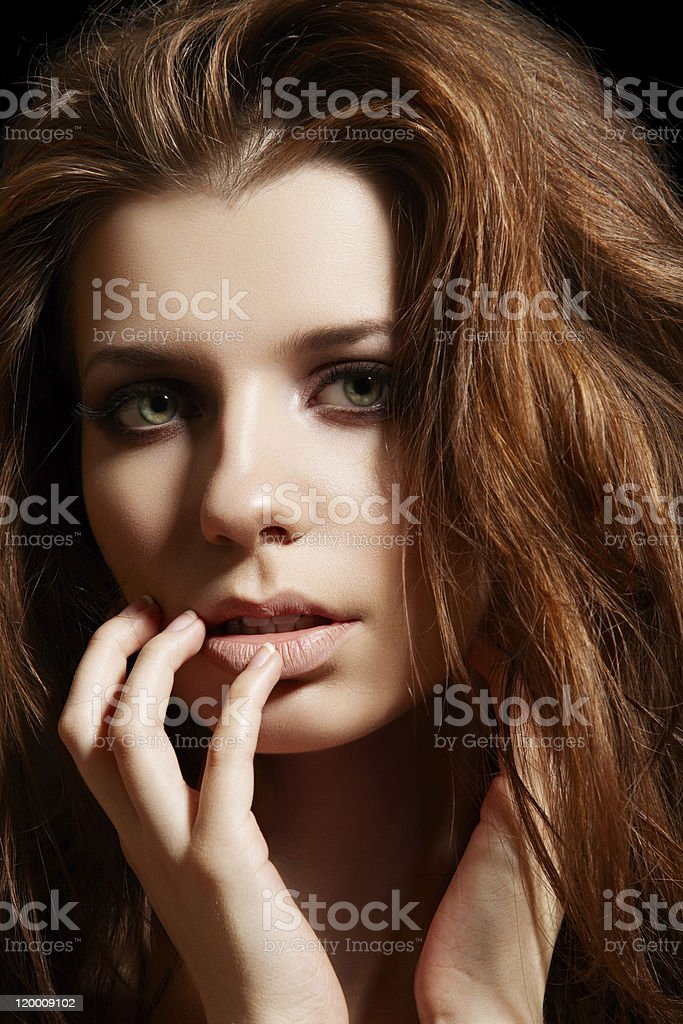 Young woman with sexy tousled hairstyle touch her face stock photo