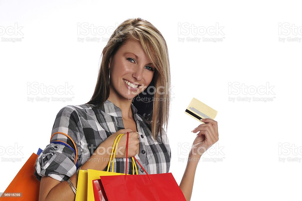 Young woman with shopping bags and credit card royalty-free stock photo