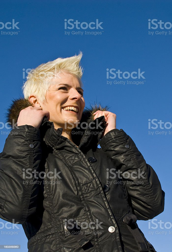 Young woman with short blond hair in a black jacket royalty-free stock photo