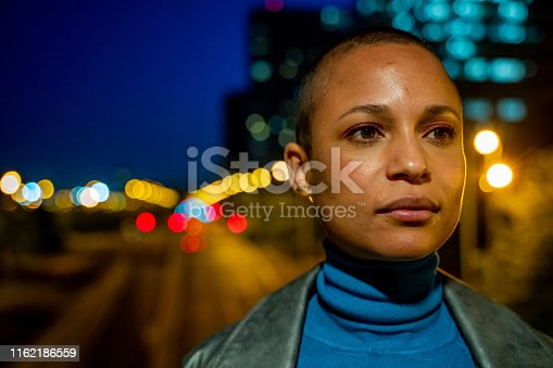 Young woman with short hair wearing a turquoise turtleneck