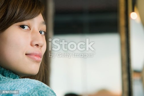 519052198 istock photo Young woman with sideways glance smiling, close-up, portrait 526420491