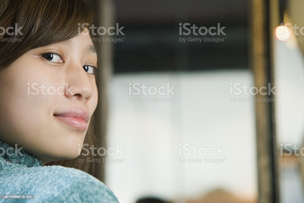 Young woman with sideways glance smiling, close-up, portrait royalty-free stock photo