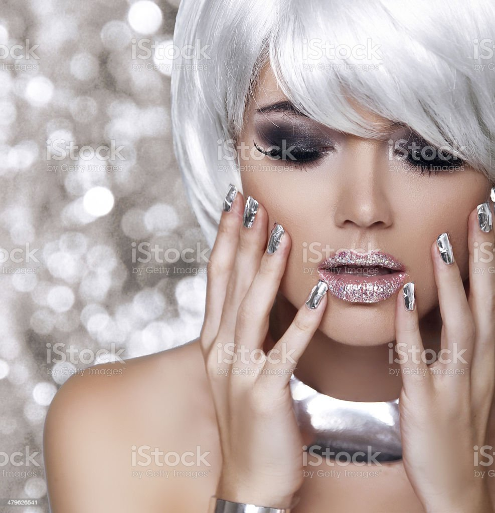 Young woman with silver and glitter accents stock photo