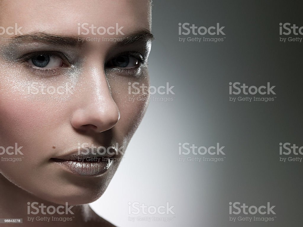 Young woman with silver make up on face royalty free stockfoto