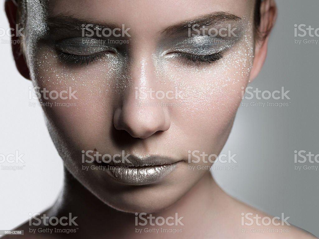 Young woman with silver make up on face royalty-free 스톡 사진