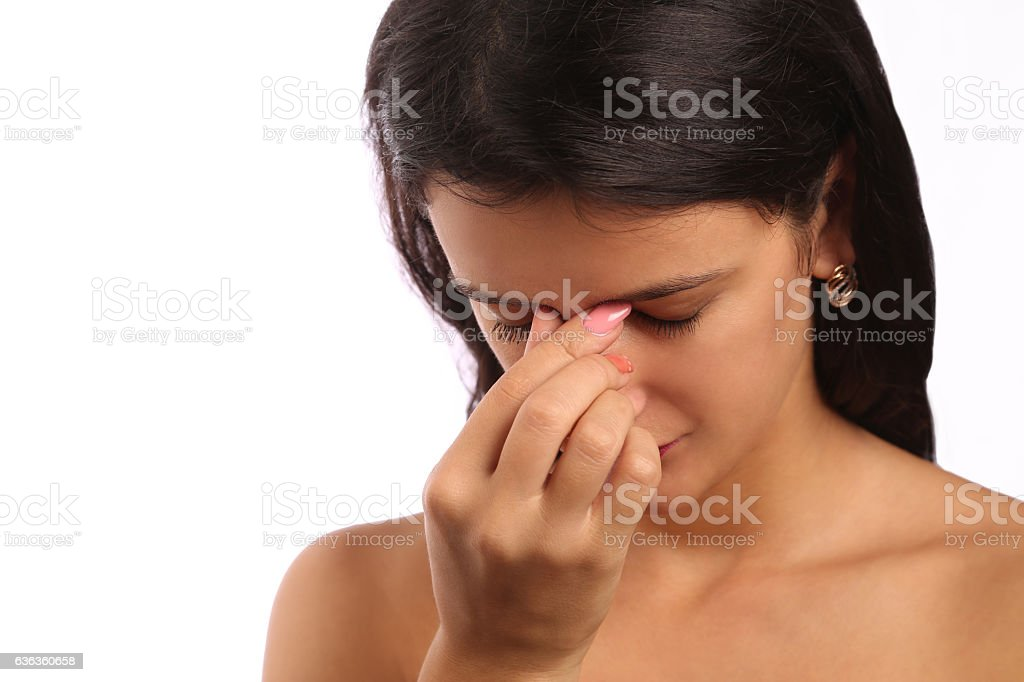 Young woman with sinus pressure pain stock photo