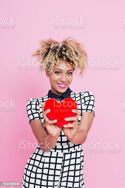 Young Woman With Small Red Heart Stock Photo - Download Image Now