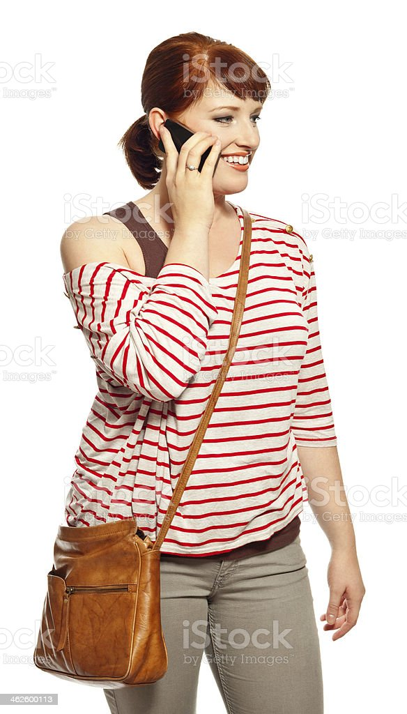Young woman with smart phone Portrait of casual young woman on the phone. Studio shot, white background. 20-24 Years Stock Photo