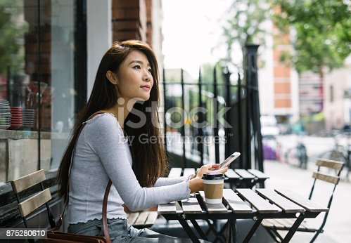 istock Young Woman With Smartphone 875280610