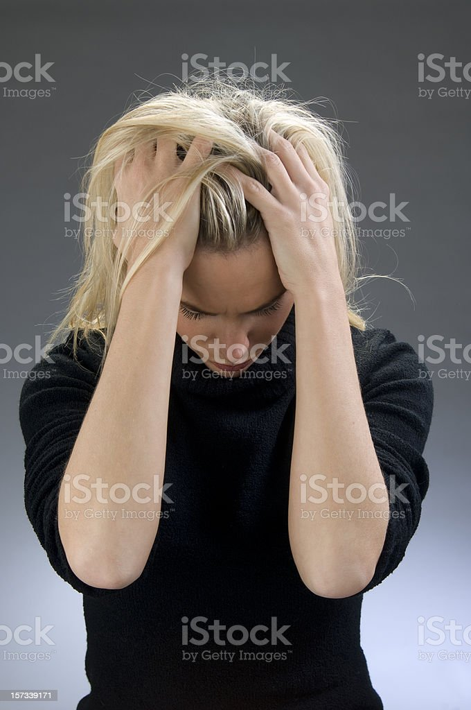 young woman with splitting headache royalty-free stock photo