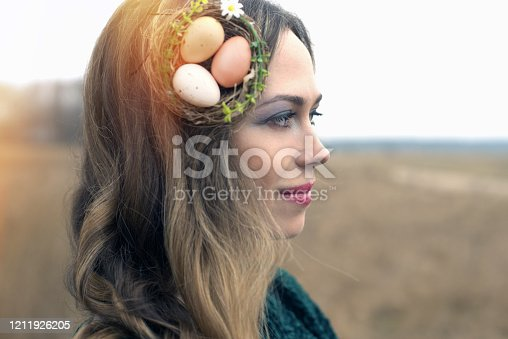 135359671 istock photo Young woman with spring make-up posing in nature, Easter look 1211926205