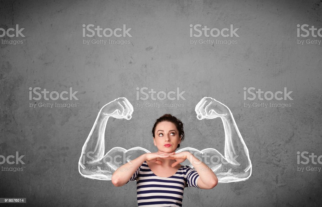 Young woman with strong muscled arms stock photo