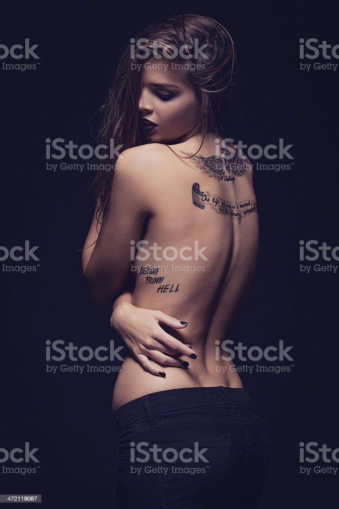 Young Woman with Tattoo stock photo