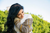 istock Young woman with the wind in her hair 1263119251