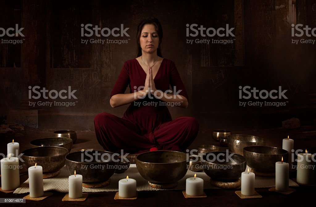 Young woman with Tibetan bowls stock photo