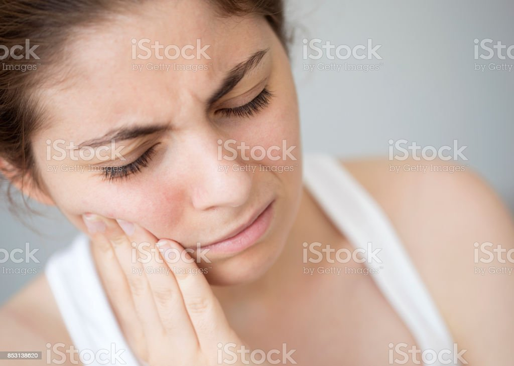 Young woman with toothache stock photo