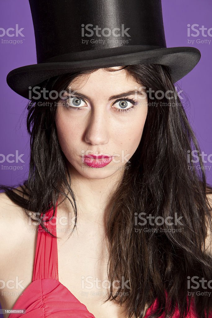Young woman with top hat stock photo