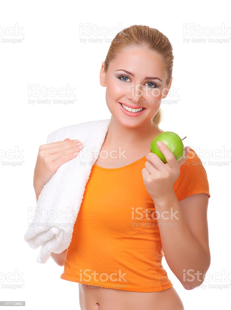 Young woman with towel and apple royalty-free stock photo