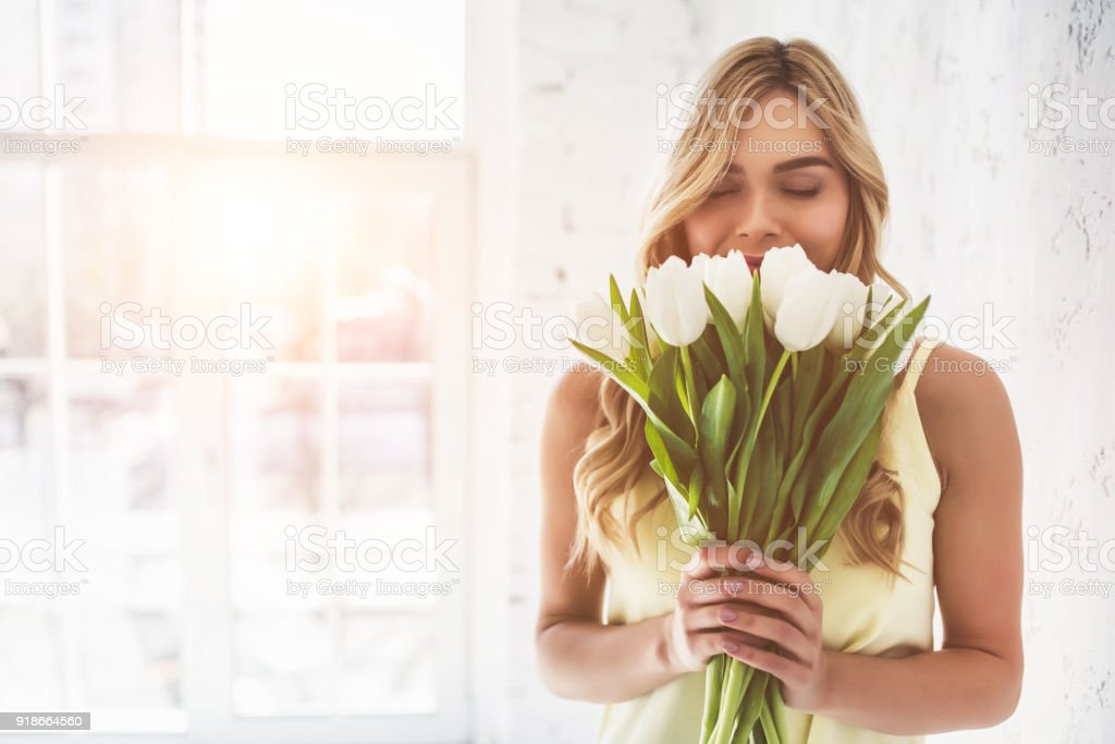 Young woman with tulips stock photo