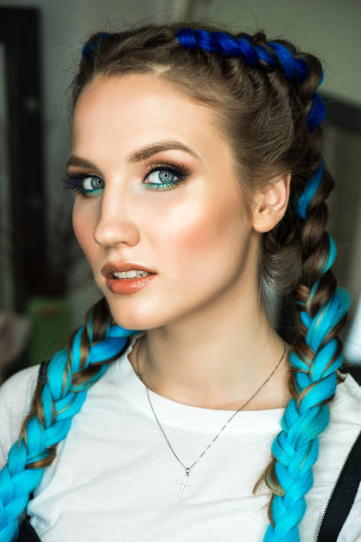 Young woman with two blue braids stock photo