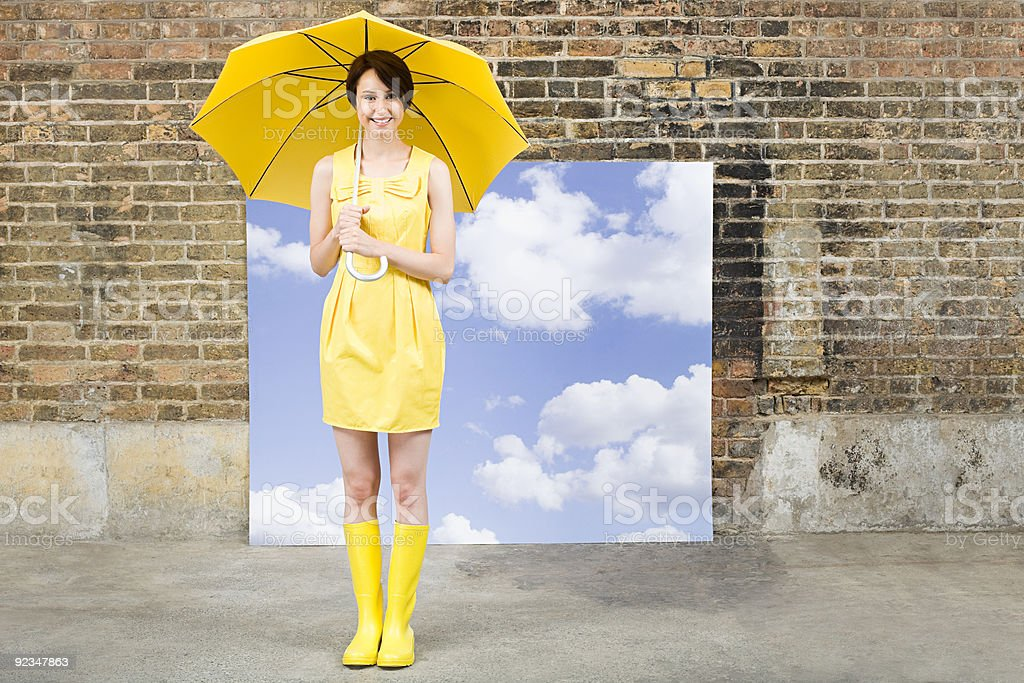 Young woman with umbrella and sky background stock photo