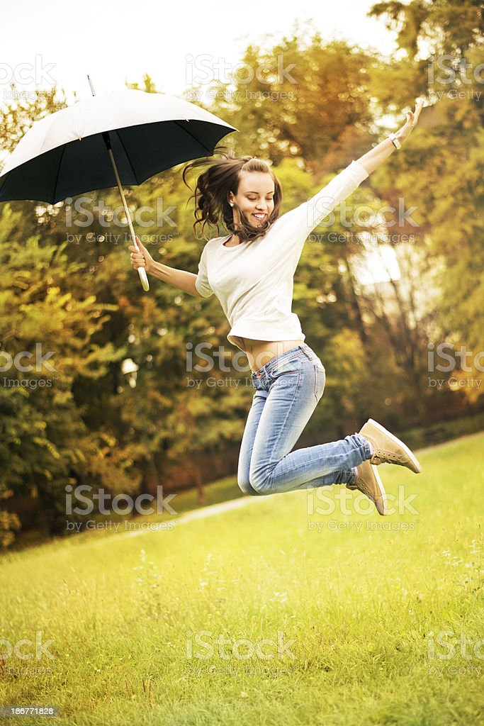 Young woman with umbrella royalty-free stock photo