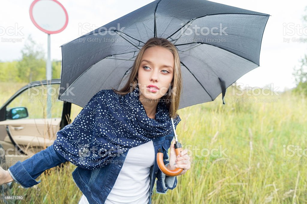 Young woman with umbrella. stock photo