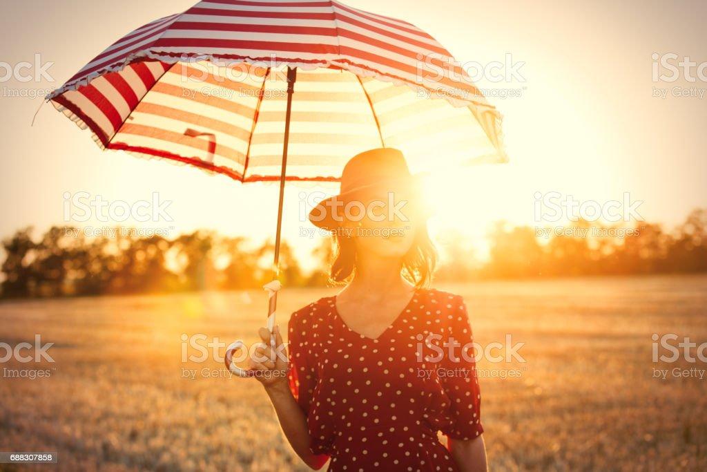 young woman with umbrella - foto de acervo