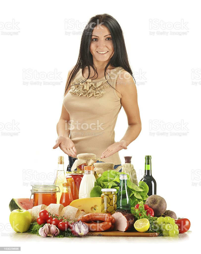 Young woman with variety of grocery products isolated on white stock photo