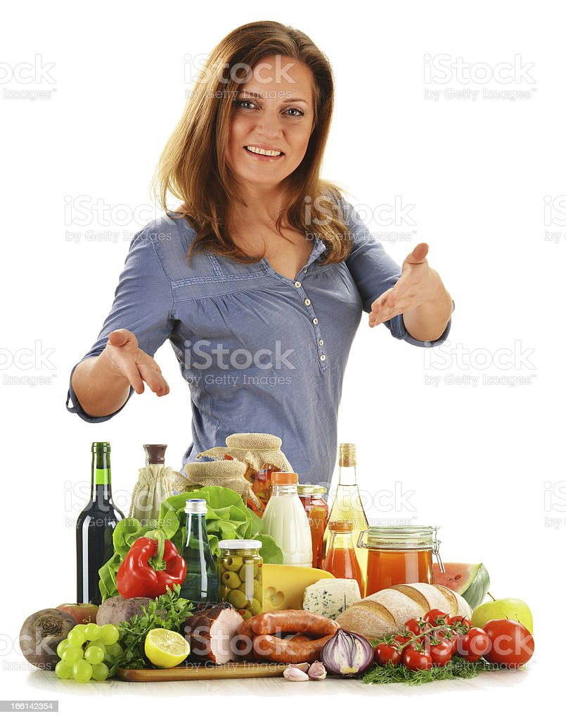 Young woman with variety of grocery products stock photo