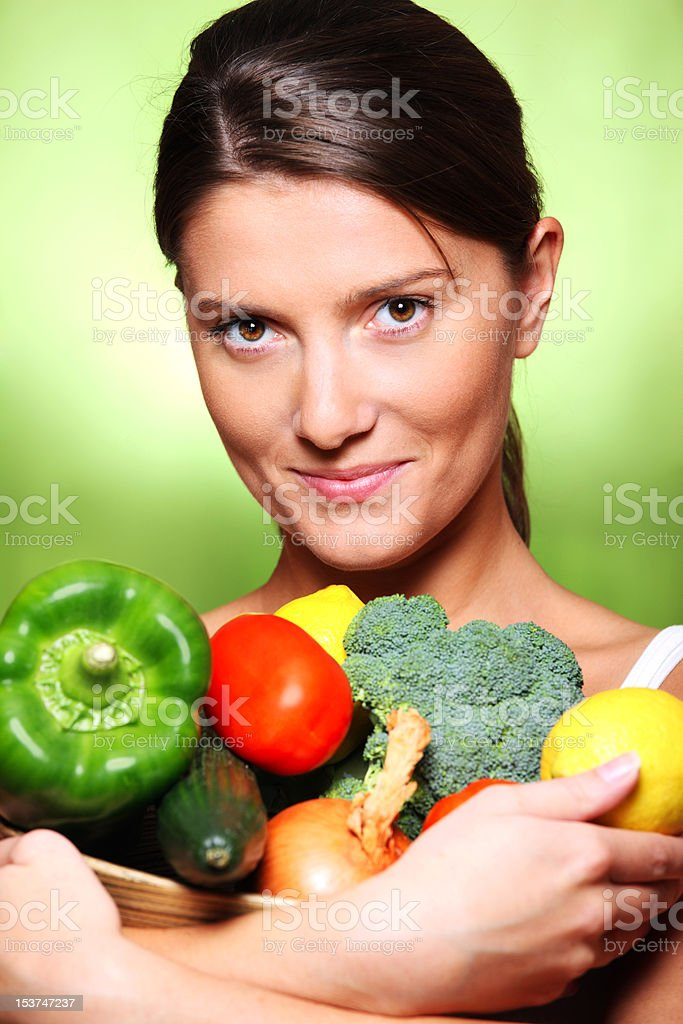Young woman with vegetable basket royalty-free stock photo