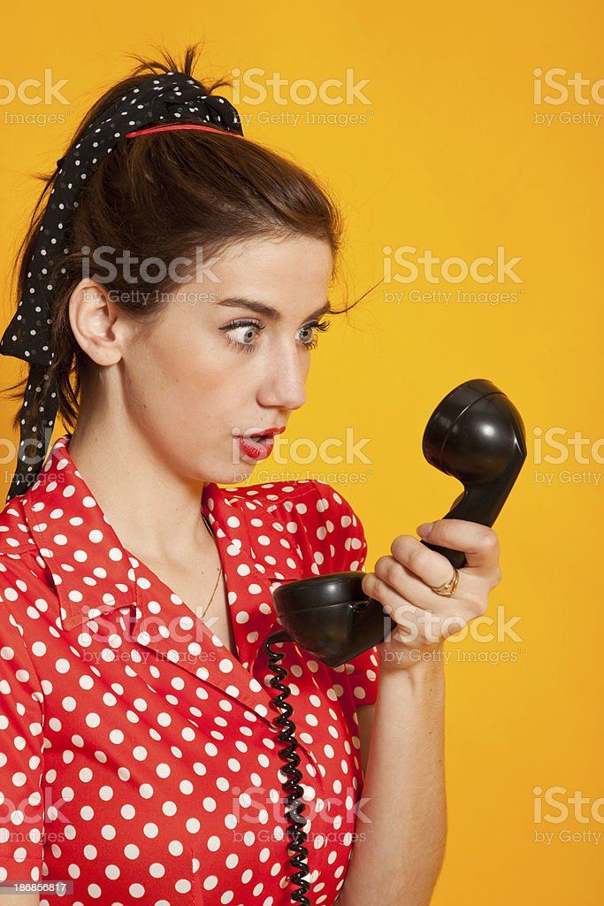 Young woman with vintage phone stock photo